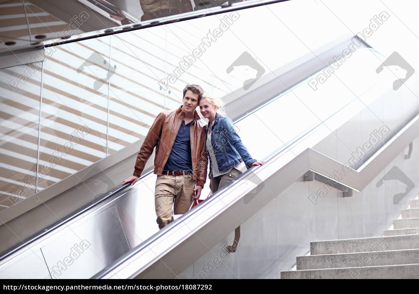 mid, adult, couple, on, escalator, , munich, - 18087292
