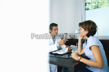 male doctor talking to a female