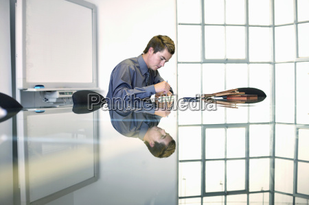view of a young businessman writing