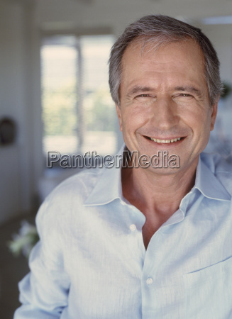 mature man smiling for the camera
