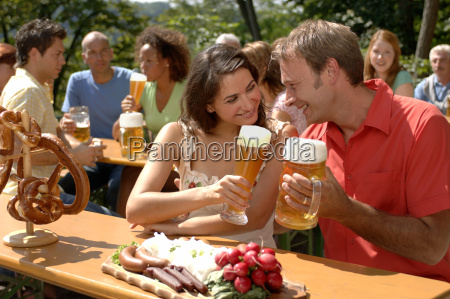 view of a young couple toasting