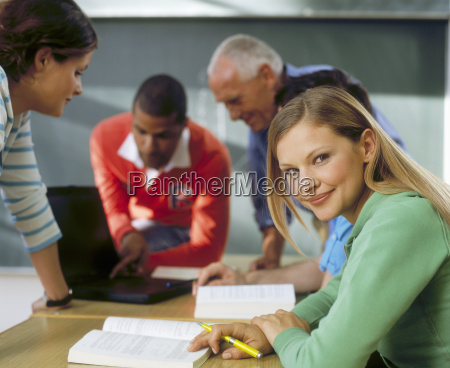 woman looking away while teacher is