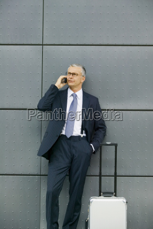 middle aged businessman on cell phone