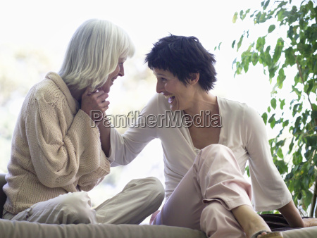middle aged female couple smiling at