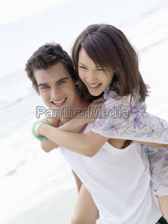 man giving woman piggyback ride at