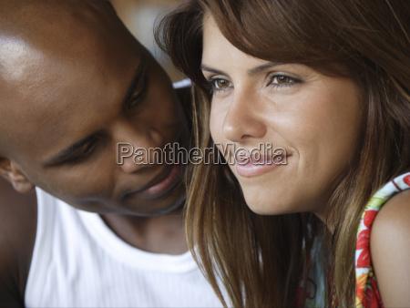 man looking at woman and smiling