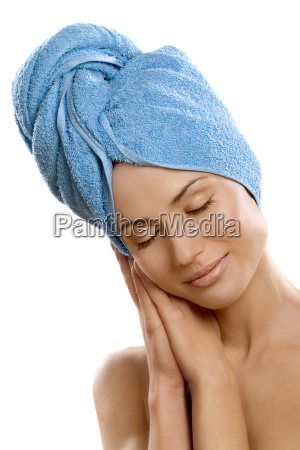 studio shot of woman with towel