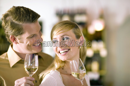 couple drinking white wine and smiling