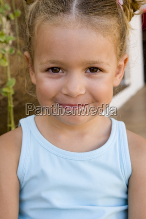close up of young girl smiling