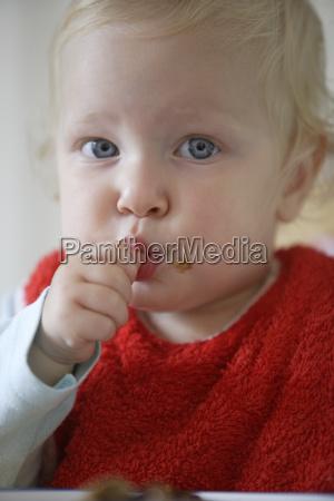 close up of baby sucking thumb