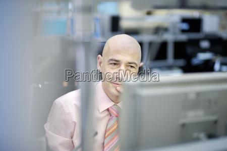 businessman looking at computer
