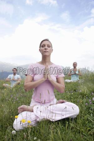 group of people practicing yoga kleinwalsertal