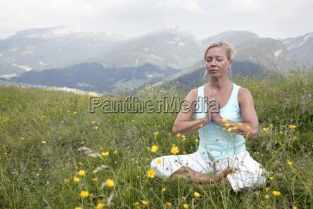 woman practicing yoga kleinwalsertal allgau germany