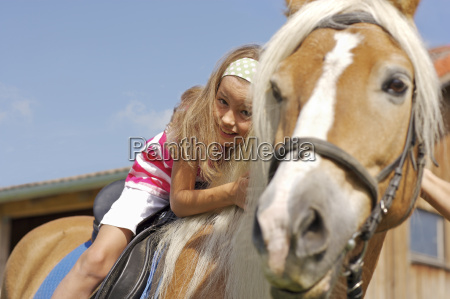 young girl on horse