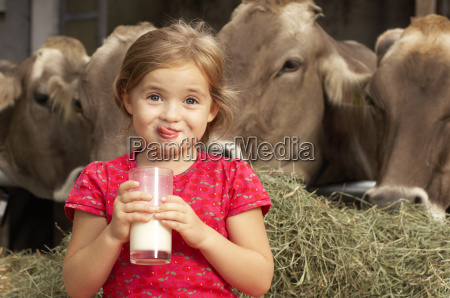 young girl drinking cows milk