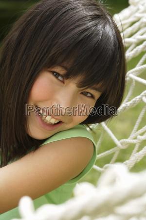 young happy girl in hammock