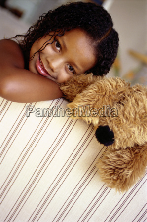 portrait african american girl and stuffed