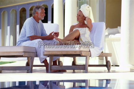 mature man and woman sitting outside