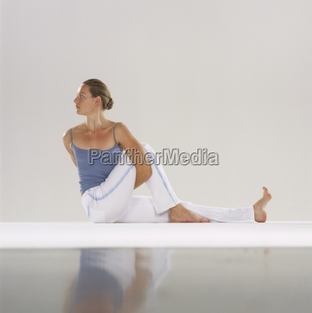 woman stretching in yoga pose looking