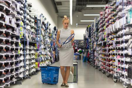 woman shopping sports equipment in sportswear