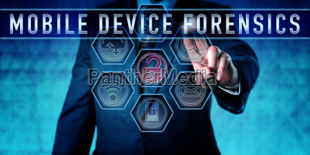 examiner pressing mobile device forensics