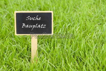 schild suche grundstueck bauplatz tafel eigenheim