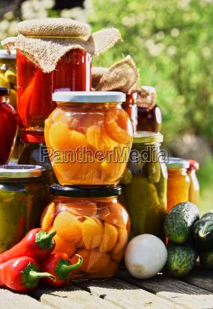 jars of pickled vegetables and fruits