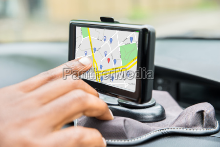 persons hand using gps service