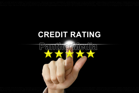 business hand pushing credit rating on