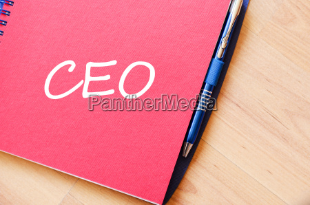 ceo write on notebook