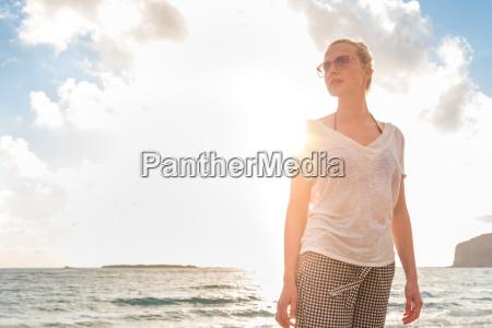 relaxed happy woman enjoying sun on