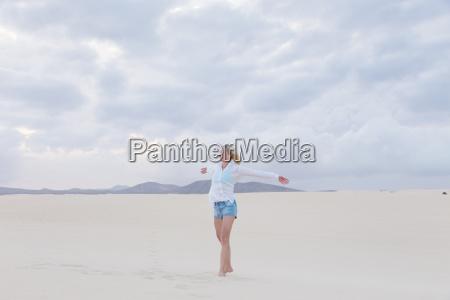 carefree woman enjoying freedom on beach