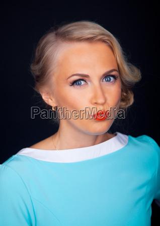 glamorous girl wearing blue dress sending