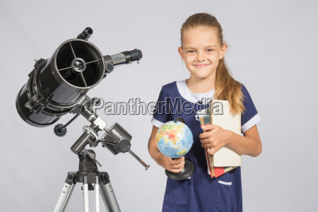 girl astronomer is a telescope with