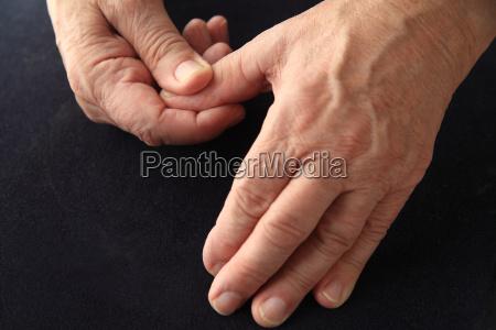 senior man with aching thumb