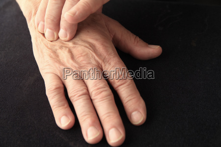 man with hand pain and copy
