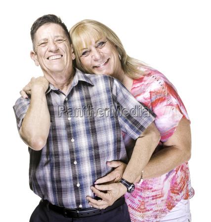 smiling transgender man and woman posing