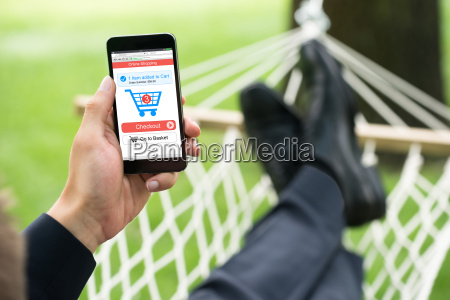person shopping online on mobile phone