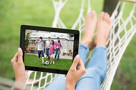 woman watching movie on digital tablet