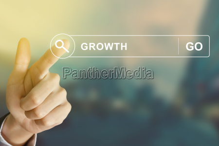 business hand clicking growth button on