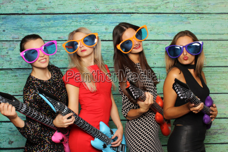 girl band with plastic guitars