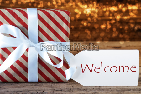 atmospheric christmas gift with label welcome