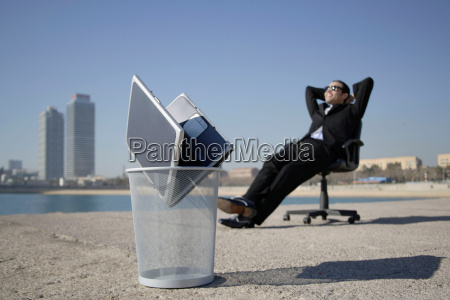 business man sitting by seafront