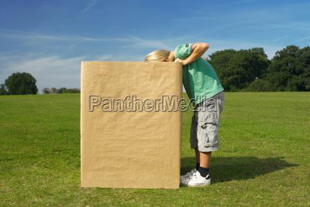 boy looking into box