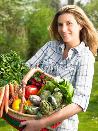 woman holding a vegetable basket