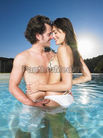 young couple in pool