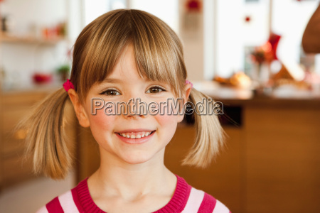 young girl smiling in kitchen