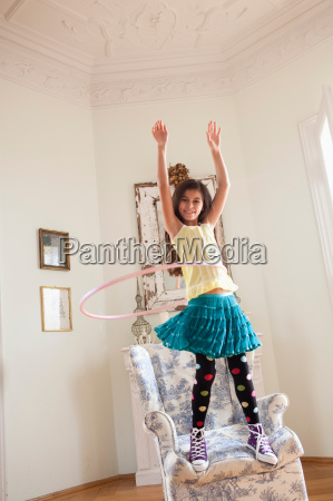 young girl playing with hoop