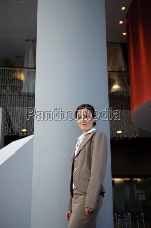business woman standing in building