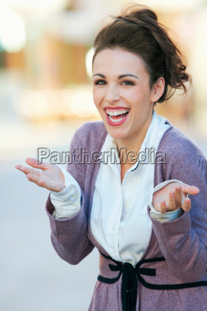 a woman laughing and gesturing to